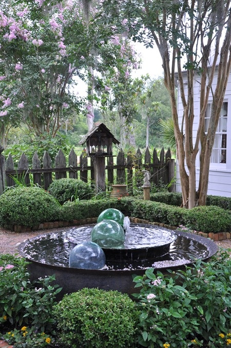 weathered fence, statuary, crepe myrtle, sugar kettle, fountain, A. Hays Town