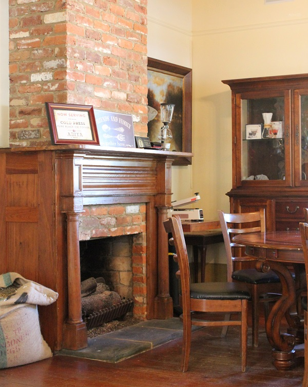 Brick Fireplace; Wood Mantle; Coffeehouse