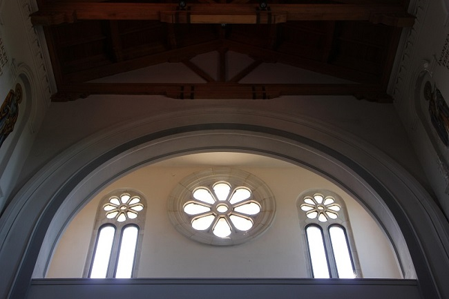 Interior view of rose windows over doors in St. Joseph Abbey Church