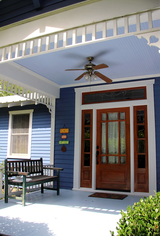 Haint Blue porch ceiling on blue painted cottage in Abita Springs Historic District