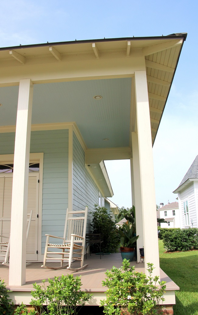 Raised cottage with Haint Blue porch ceiling in TerraBella Village, a traditional neighborhood development in Covington, Louisiana
