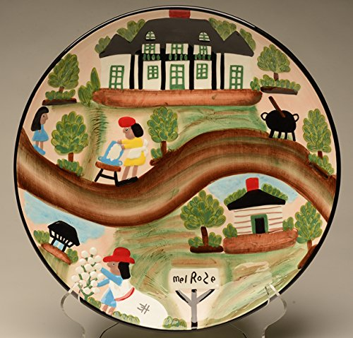 Clementine Hunter ceramic platter with pattern 'A Day at Melrose Plantation'. In this artist rendering, the famous Louisiana folk art painter captures the structures, painting doors, windows, and shutters with Haint Blue, at the historic Melrose Plantation on the Cane River