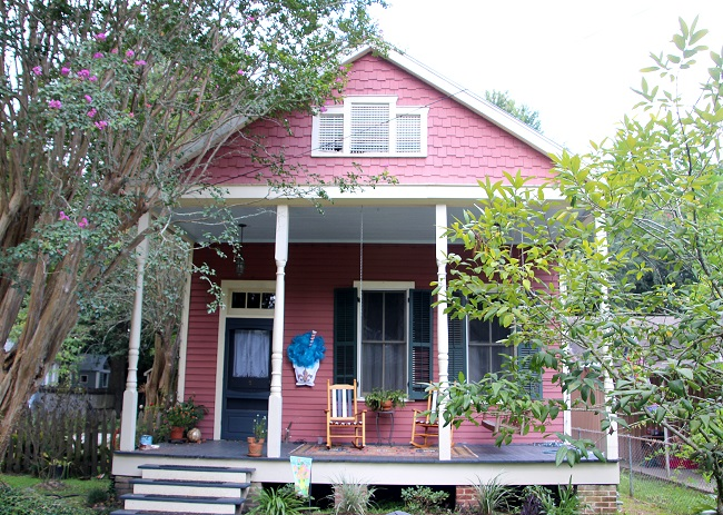 Haint Blue porch ceiling and horizontal slat shutters on a three bay shotgun house in the Abita Springs Historic District