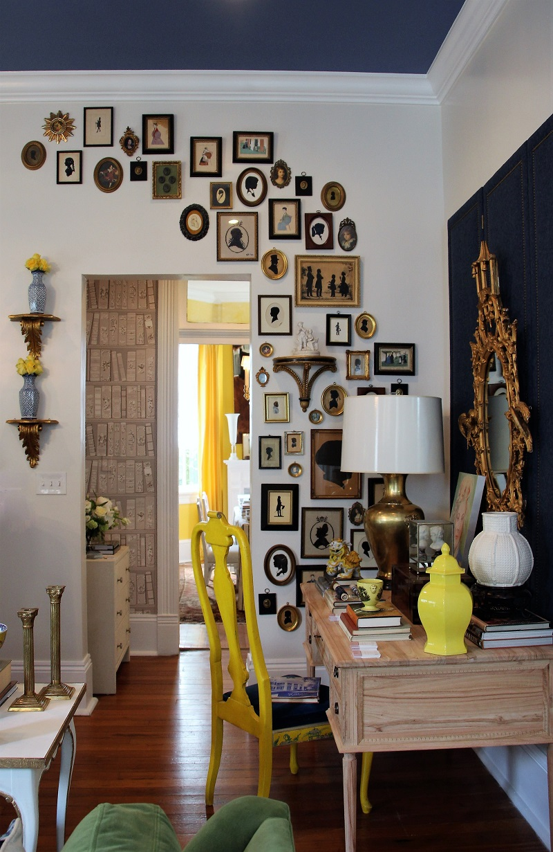 Traditional Home's Southern Style Now Showhouse in New Orleans, Family Room by Parker Kennedy, Gallery Wall of Framed Silhouettes