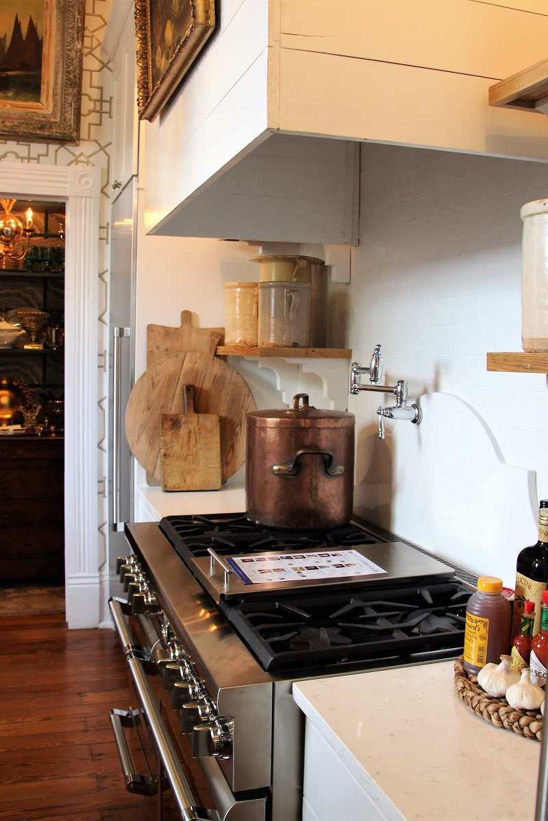 Traditional Home's Southern Style Now Showhouse in New Orleans, Kitchen, terra-cotta containers, antique bread boards, copper stock pot, and shiplap hood over Thermador range
