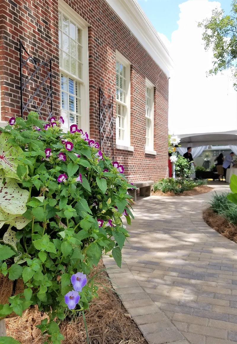 Garden House of Southern Hotel, lush garden, potted plants, brick walkway; eclectic interiors