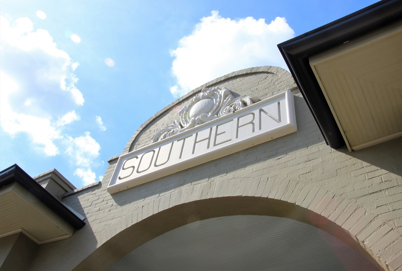 Southern Hotel sign, eclectic classic glamour interiors; photo by Patricia Shutts Spicuzza